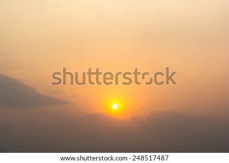 view of sky with clouds and sun in the evening - stock photo