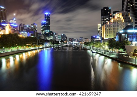 View of skyline and Yarra River in Melbourne CBD at night - stock photo