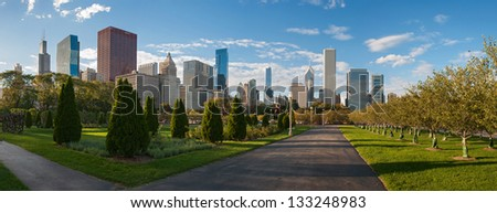 View of skyscrapers from Millennium Park in Chicago at sunset - stock photo