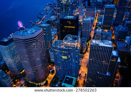 View of skyscrapers in downtown at night, in Seattle, Washington. - stock photo