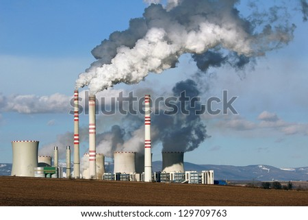 view of smoking coal power plant - stock photo