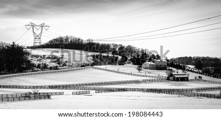 View of snow-covered farm fields and rolling hills in rural Carroll County, Maryland. - stock photo