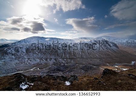 View of snow covered mountains, Corrour Estate, Scotland - stock photo