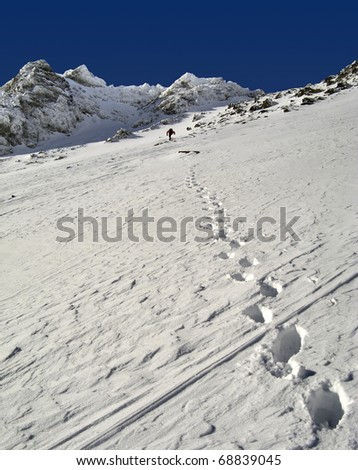 View of snow mountain and hiking man. Slovakian  High Tatra Mountains. - stock photo