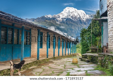 View of snowed mountain peak from a tourist lodge in Himalayas, Nepal - stock photo
