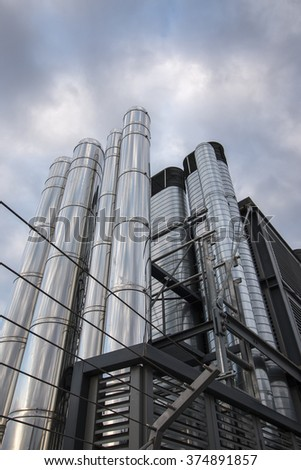 View of some air pipe ventilation chrome tubes on top of a building. - stock photo