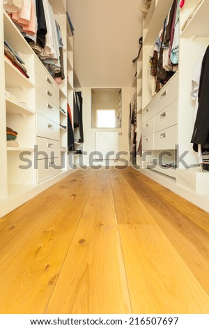 View of spacious walk-in closet in modern house - stock photo