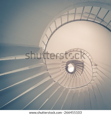 View of spiral staircase from the ground looking up. Vintage effect. - stock photo
