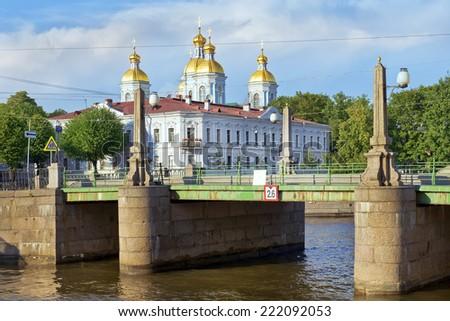 view of St. Nicholas Naval Cathedral from the Pikalov bridge in St. Petersburg, Russia - stock photo