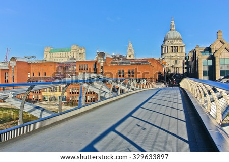 View of St Paul's Cathedral from the Millennium Bridge in London - stock photo
