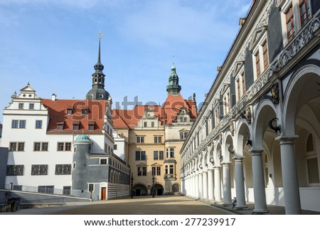 View of Stables Courtyard (Stallhof) toward Chancellery Building, George Gate and Hausmannsturm tower of Dresden Castle, Saxony, Germany. - stock photo