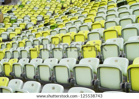 View of stadium stands with seats for spectators - stock photo