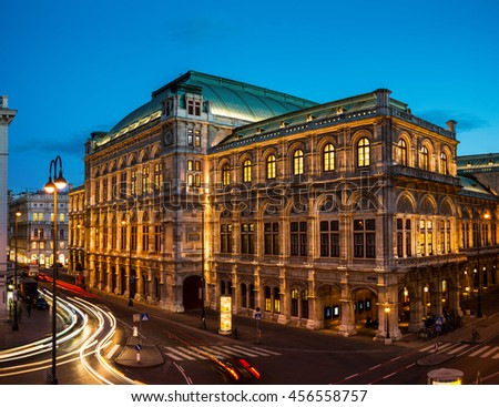 View of State Opera in Vienna, Austria during the night. Bright blue sky, car light trails - stock photo