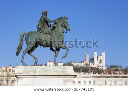 View of statue and Basilica in Lyon, France. - stock photo