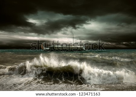 View of storm seascape with historical ship - stock photo