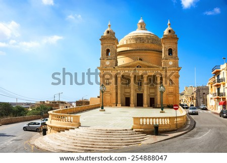 View of street and church in Mgarr, Malta.  - stock photo