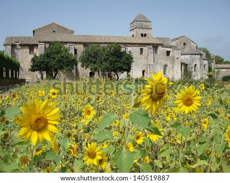 View of sunflowers over to the asylum in St Remy where Van Gogh stayed and painted - stock photo