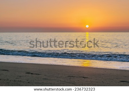 view of sunrise with sea in Torremolinos, Spain - stock photo