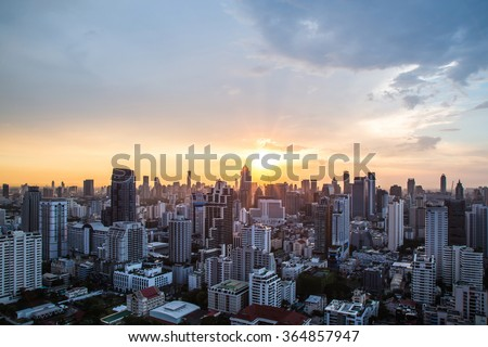 view of Sunset over city scape - stock photo