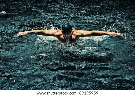 view of swimmer in swimming pool - stock photo