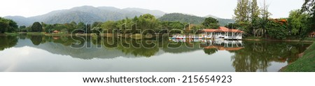 View of Taiping Lake Garden in Malaysia with paddleboats on the lake - stock photo