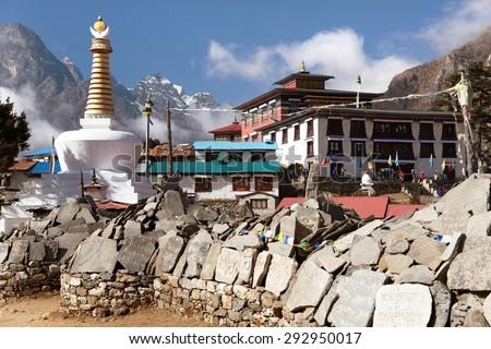 View of Tengboche monastery with stupa and prayer mani wall, Khumbu valley, Sagarmatha national park, Nepal - stock photo