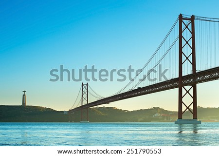 View of 25th of April Bridge at sunset in Lisbon, Portugal  - stock photo