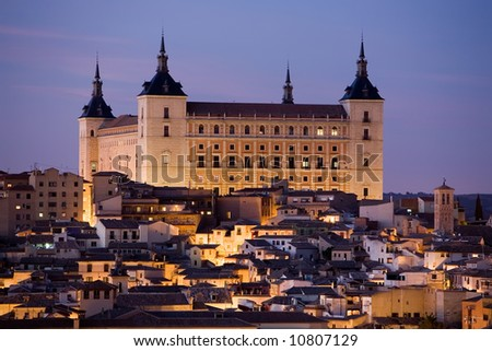 View of the Alcazar in Toledo, Spain at dusk. - stock photo