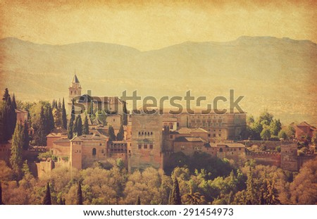 View of the Alhambra from the Albayzin of Granada,  Andalusia, Spain. Photo in retro style.  Added  paper texture. - stock photo