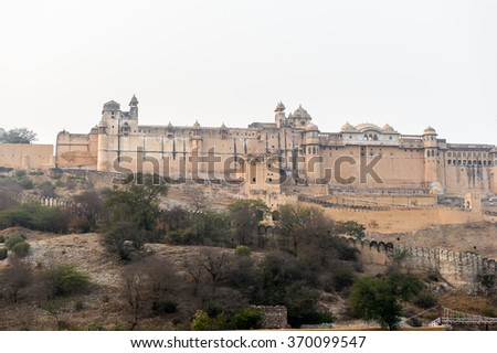 View of the Amer Fort (Amber Fort and Amber Palace) and the lake Jaipur, Rajasthan state, India. UNESCO World Heritage Site as part of the group Hill Forts of Rajasthan. - stock photo