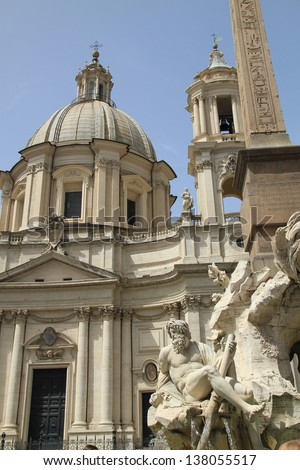 View of the ancien palace in Piazza Navona with the gorgeous fountain in the foreground - stock photo