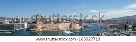 """View of the ancient castle """"Saint Jean"""" and the harbor """"Vieux Port"""" of Marseille in South France - stock photo"""