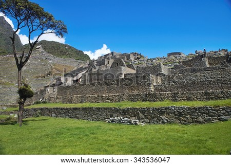 View of the ancient Inca City of Machu Picchu. The 15-th century Inca site.'Lost city of the Incas'. Ruins of the Machu Picchu sanctuary. UNESCO World Heritage site.Peru - stock photo