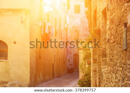 View of the ancient old european city. Street of Pienza, Italy. Sunny travel background. - stock photo