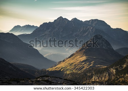 View of the Austrian mountains 'Loferer Steinberge' in the warm evening light - stock photo