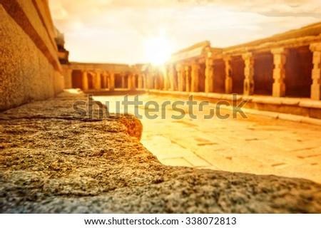 View of the Bala Krishna temple with dramatic bright sun, Hampi, Karnataka, India. - stock photo