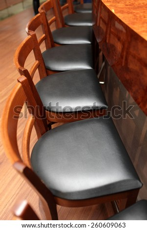 View of the bar stools in a restaurant - stock photo
