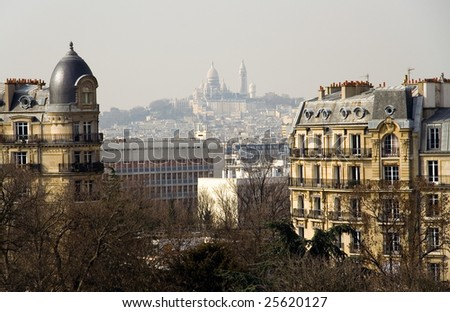View of the Basilica Sacre-Coeur from the park des Buttes-Chaumont, Paris, France - stock photo
