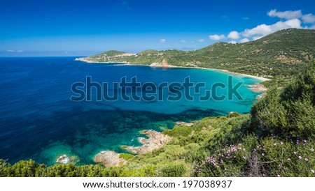 View of the beach and coastline at Cargese on the west coast of Corsica - stock photo