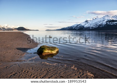 View of the beach on the Chilkat Inlet near Haines Alaska in warm evening light. - stock photo