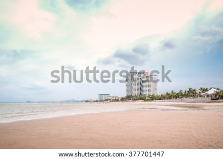 View of the beautiful beach resort on perfect tropical white sand beach for vacations, Prachuap Khiri Khan Province, Thailand. Thailand beach exotic island, Tropical paradise for asia holiday. - stock photo