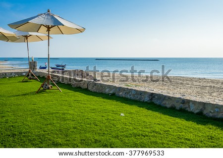 View of the beautiful beach resort with lounge umbrellas for vacations in Cha Am, Phetchaburi Province, Thailand. - stock photo