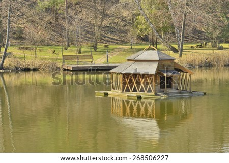 View of the beautiful lake in a landscape park - stock photo