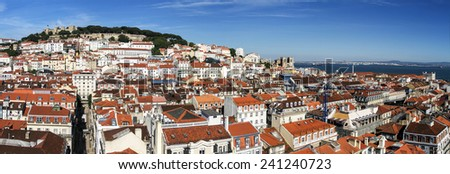 View of the beautiful Lisbon downtown area with landmark castle of Sao Jorge on top of the hill. - stock photo