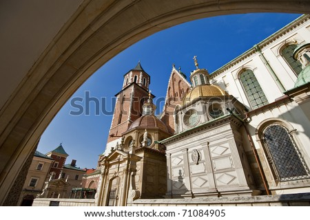 View of the beautiful Saint Stanislas Cathedral at Wawel castle, Krakow, Poland, viewed from behind a gothic arch - stock photo
