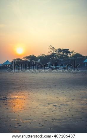 View of the beautiful sunset in tropical beach resort in Chao Samran beach, Phetchaburi Province, Thailand. - stock photo