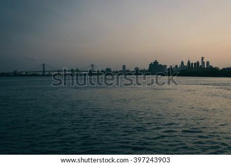 View of the Ben Franklin Bridge and Philadelphia skyline over the Delaware River, in Philadelphia, Pennsylvania. - stock photo