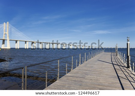 view of the big Vasco da Gama bridge in Lisbon - stock photo