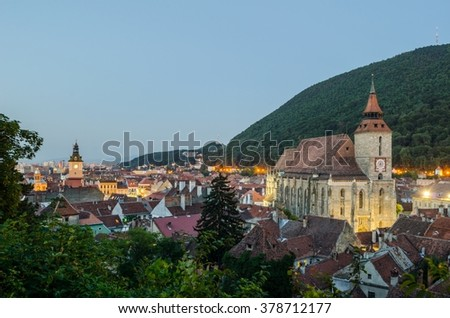view of the black church and historical center of romanian city brasov during sunset - stock photo