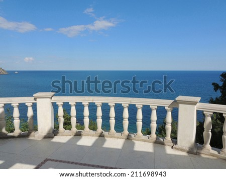 View of the Black Sea from the Seaside Park in  Partenit in Crimea. White balustrade in the classical style. Park Aivazovsky In Partenit, Crimea. Southern coast of Crimea. - stock photo